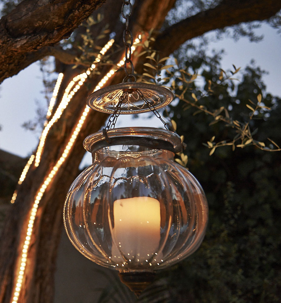Beautiful Enjoy Platinum flameless candle hanging outdoors